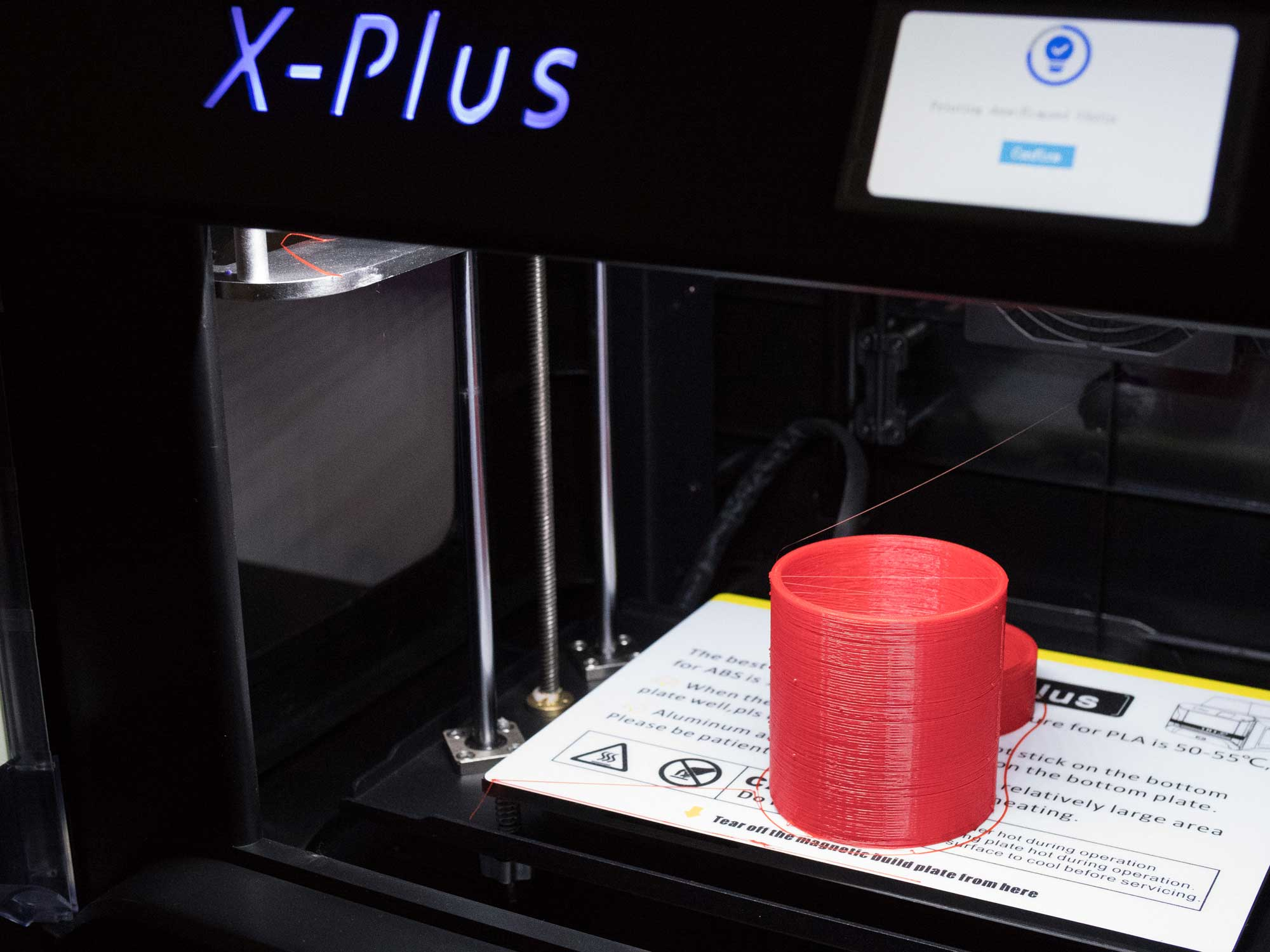 The dew shield being fabricated on the QIDI X-Plus 3D printer