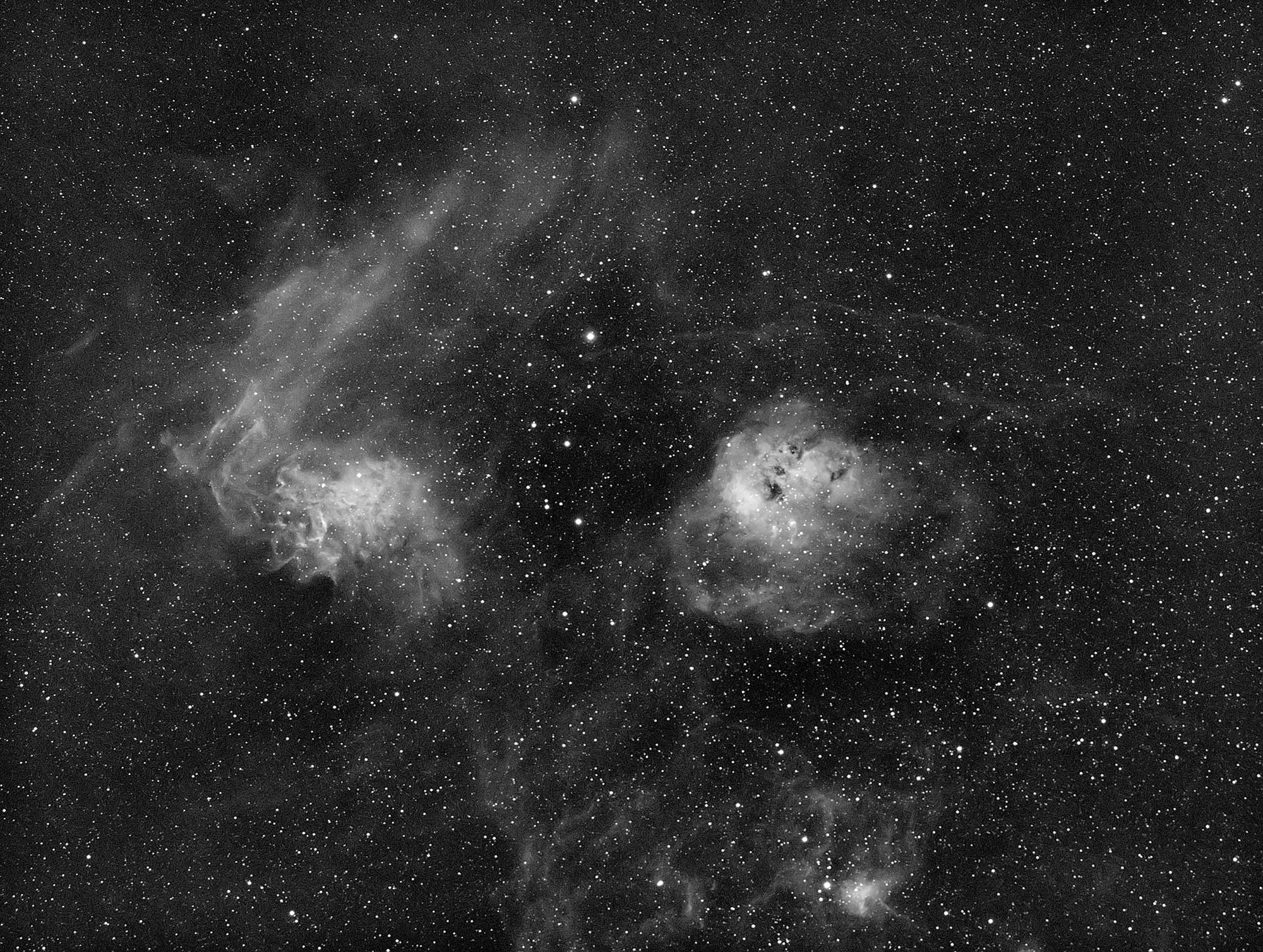 The Flaming Star nebula (IC405) to the left and NGC 1893 to the right.
